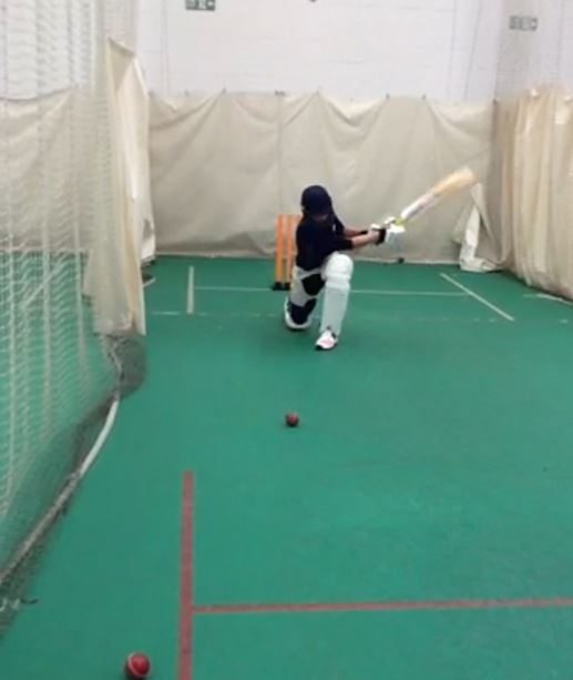 cricket coaching scene in the nets